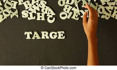 Target Your Customers - A person spelling Target Your...