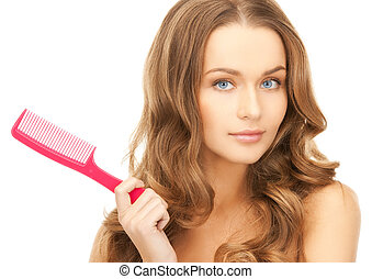 woman with brush - beautiful woman with long curly hair and...