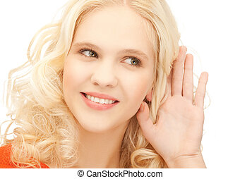 girl listening rumors - bright picture of smiling girl...