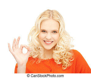 young woman showing ok sign - bright picture of young woman...