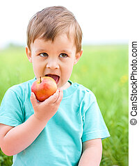 Portrait of a little boy with apple