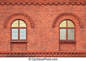 Two windows. - The Windows of the house from a red brick....