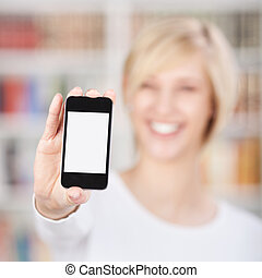 Woman Displaying Mobile Phone In Library - Closeup of woman...