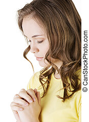 Young pretty caucasian girl praying over white background