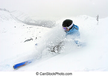 Powder - Woman skiing in deep powder