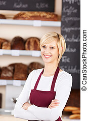 Waitress With Arms Crossed Standing In Bakery - Portrait of...