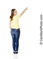 Happy , excited young woman pointing on copy space, isolated...