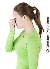 Young woman with sinus pressure pain , isolated.