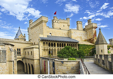 Olite Castle, Navarre - Olite Castle with a sky of clouds in...