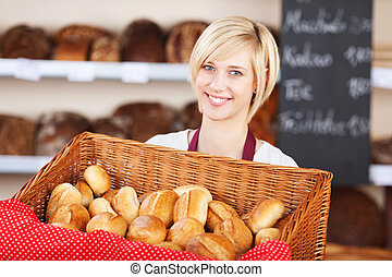 Waitress With Bread Basket In Cafe - Portrait of young...