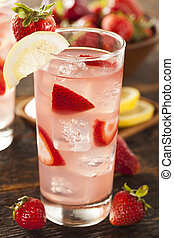 Refreshing Ice Cold Strawberry Lemonade on a background