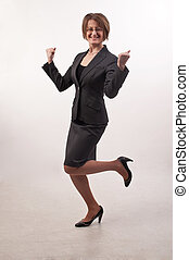 Business woman with glasses celebrating success, happy for...