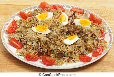 Homemade biryani - Homemade beef biryani garnished with egg,...