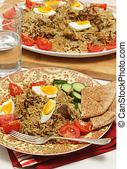 Beef biryani meal vertical - Beef biryani served with...