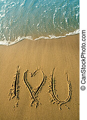 i love you - I love you written in sand on a beach, water in...