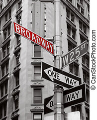 broadway - red broadway sign in a black and white photo of...