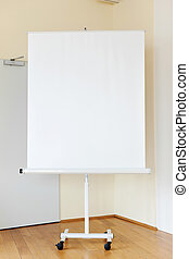 Blank Flip Chart In Boardroom - Blank flip chart on hardwood...