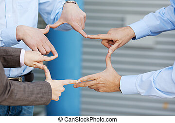 Businesspeople Joining Fingers - Closeup of businessmen and...