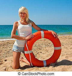 Beautiful lifeguard at sea - Beautiful slim girl on the...