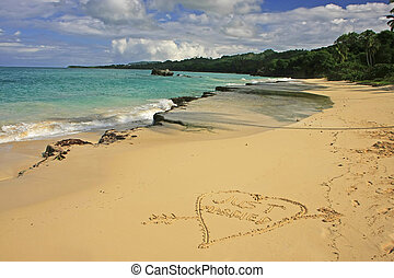 """""""Just married"""" written in sand on a beach"""