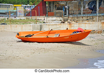 Boat at beach lifeguard station - Plastic boat at beach...