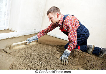 Plasterer concrete worker at floor work - Plasterer at...