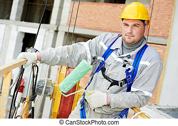 Portrait of builder facade painter at work - builder worker...