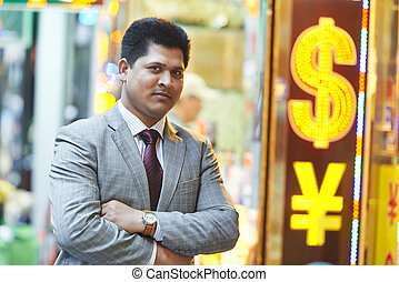 Smiling young indian businessman - Portrait of a young asian...