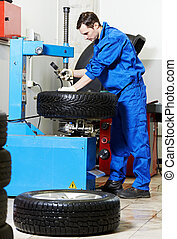 mechanic at auto wheel tyre changer - mechanic repairman...