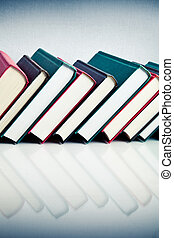 Red, black and green books in a row