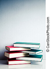 Stack of books in balance - Stack of green and red books in...