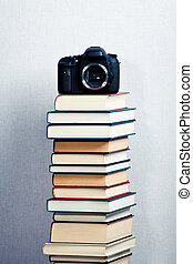 Camera on a high stack of books - Picture Camera on a high...