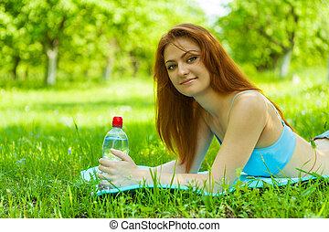a beautyful brunette on grass