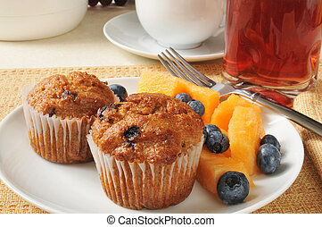 Bran muffins with fruit - A plate of bran muffins with...
