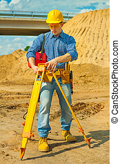 a young contractor with theodolite