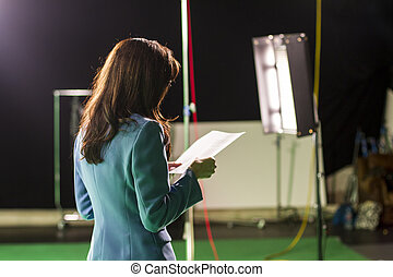 Actress Holding Script Rehearsing in Set