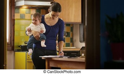 Multitasking mom cooking, working - Busy woman on the phone,...