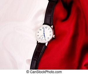 Men's mechanical watch on a backgro