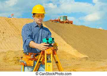 contractor with theodolite