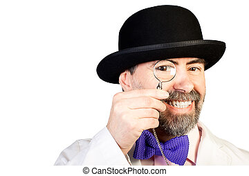 Portrait of happy middle-aged man in a hat with a monocle in...