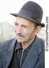 Portrait of elderly man in hat