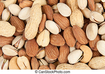 nuts background 4 - Close-up fresh salted nuts background