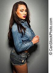 sexy brunette woman wearing jeans jacket