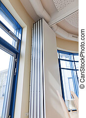 Sliding Door In Office - Low angle view of sliding door in...