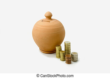 Money box with coins - Clay money box with piles of Euro...