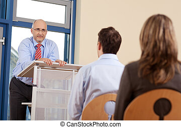 Businessman Giving Presentation - Portrait of businessman...