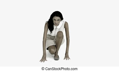 Businesswoman ready to race on white background in slow...