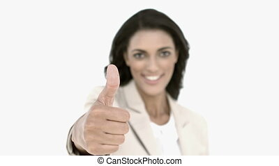 Businesswoman giving the thumbs up in slow motion