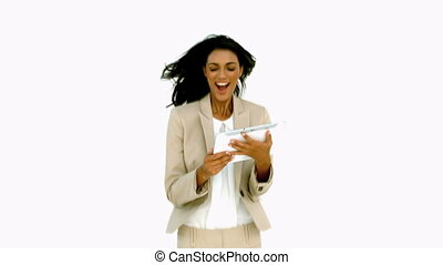 Businesswoman jumping and holding t