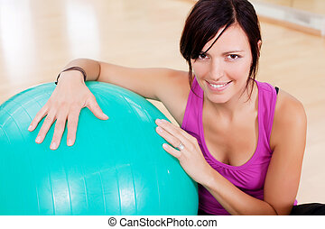 Fitness woman - Young woman doing fitness exercise with big...